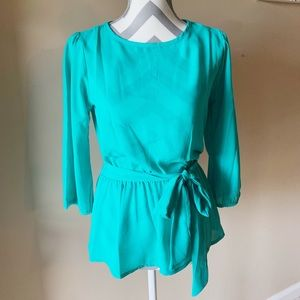 Boutique NWT cinched waist top.